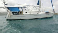 Jeanneau Sun Odyssey 40 DS : Vue tribord, Capote rigide, Taud et Portique